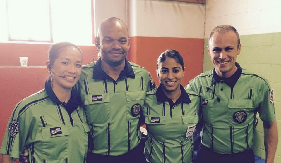 Deleana poses with her NWSL game crew during a 2015 match. Pictured L-R are: Deleana Quan (AR1), Chipalo Street, (4th Official, WA), Christina Unkel (Referee, FL), and Josh Haimes (AR2, WA). Photo Courtesy of Deleana Quan